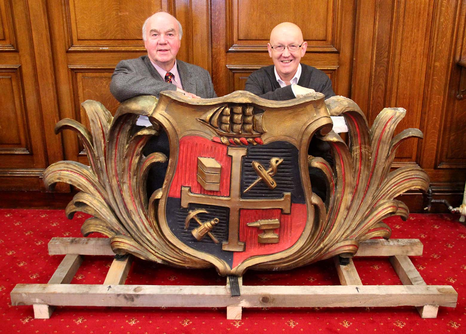 Councillor Graham Shuttleworth, Chair of Chadderton District Partnership, and Councillor Eddie Moores, Deputy Cabinet Member for Economy and Enterprise and Chadderton Central ward councillor, with the restored Chadderton crest.