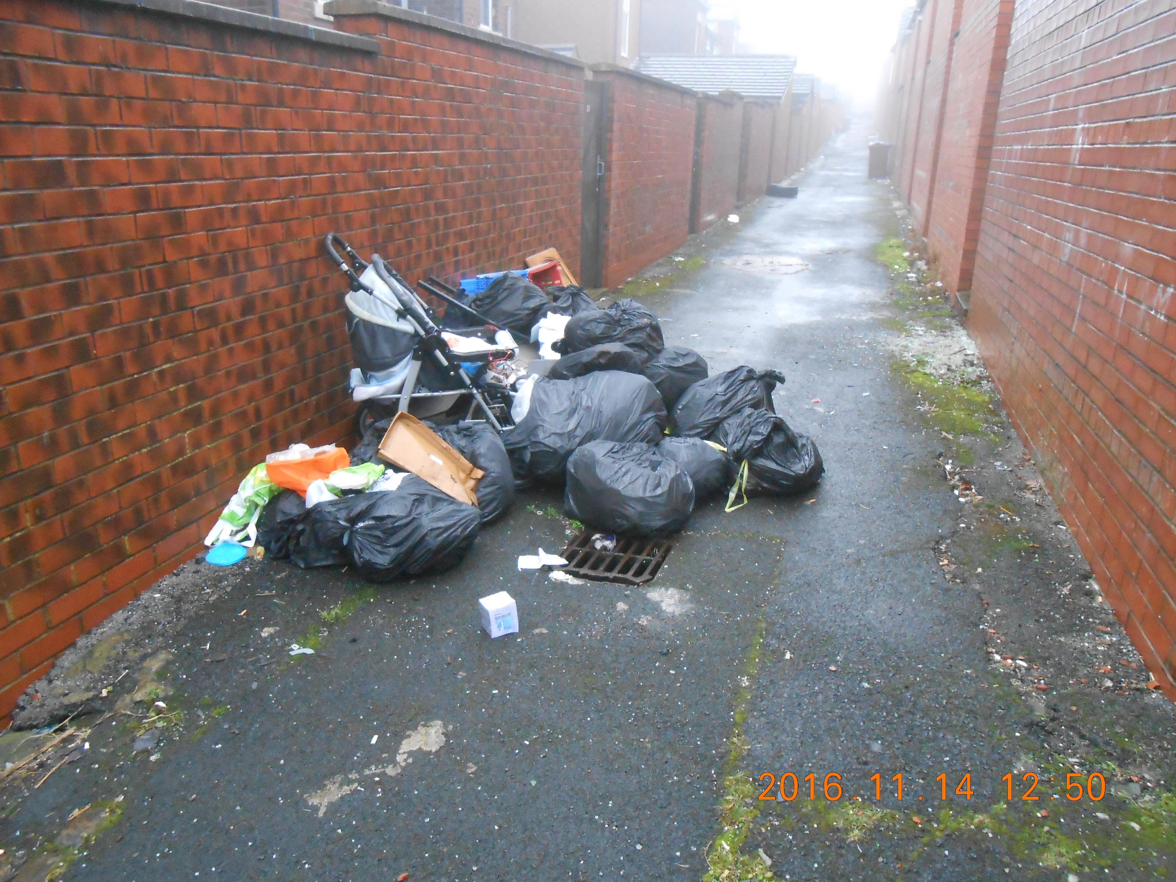 Oldham Council has fined another resident for fly-tipping after she dumped her waste in an alleyway.