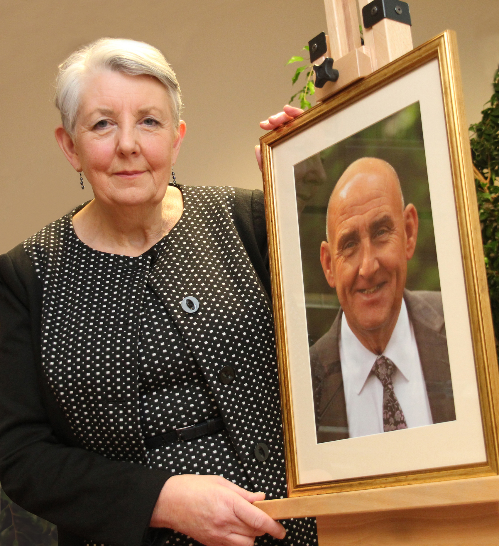 Councillor Jenny Harrison with a picture of her late husband, Councillor Philip Harrison at a commemorative event which saw Th eLink Centre's function suite renamed in his honour