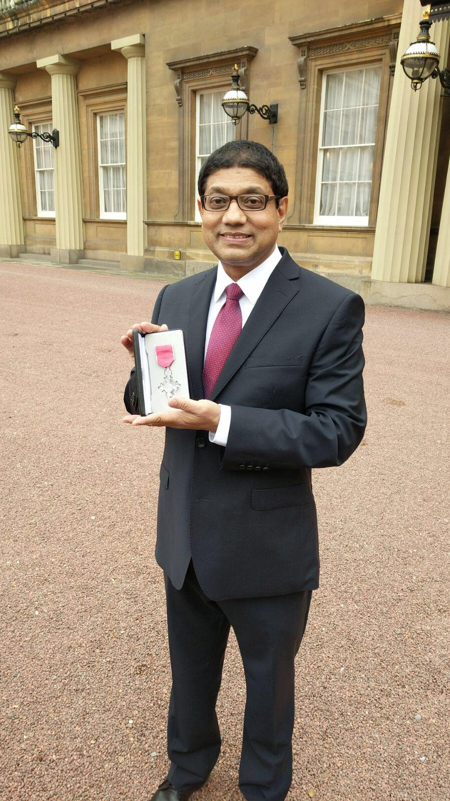 Oldham Council's Deputy Leader has received his MBE at Buckingham Palace.