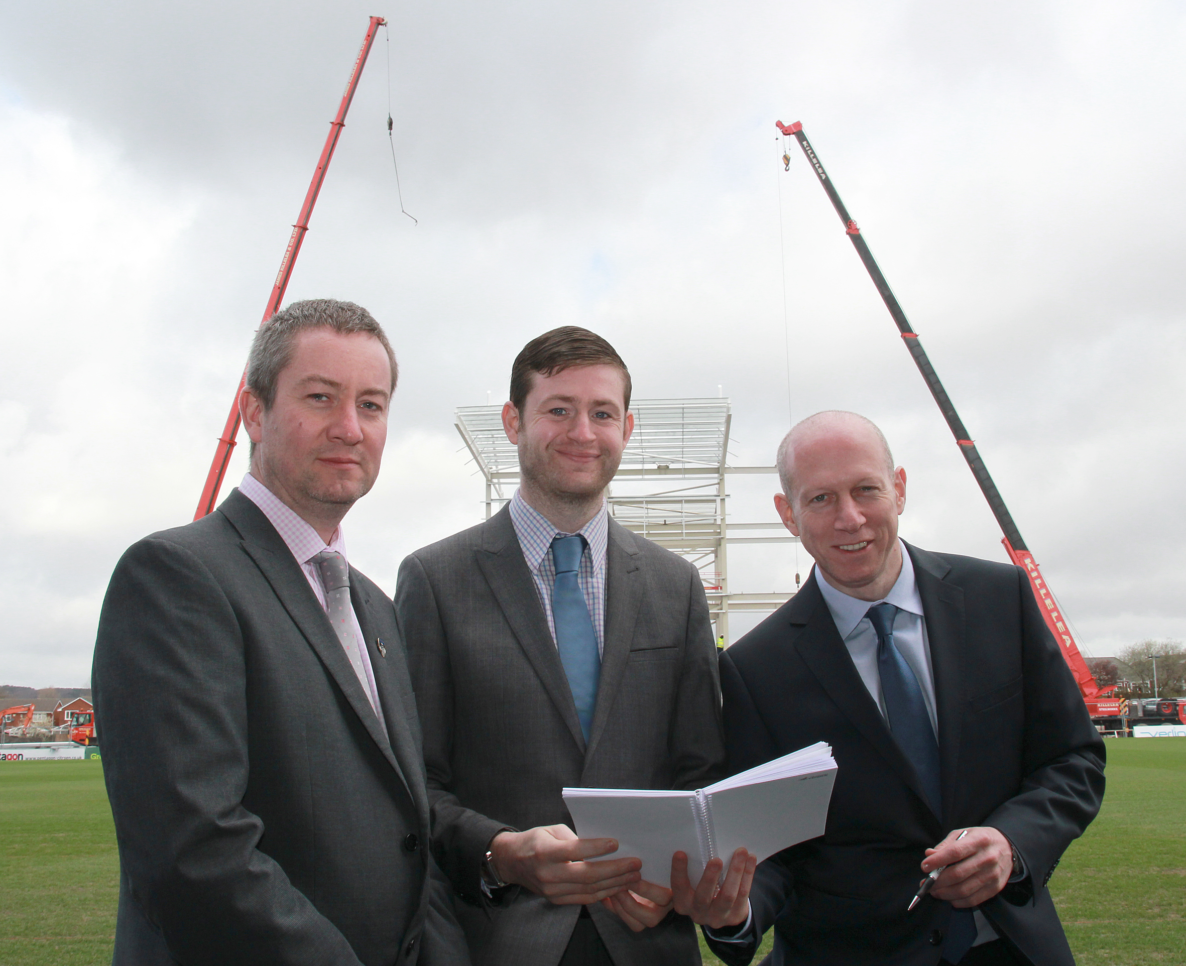 Neil Joy, Latics' Chief Executive with Jim McMahon, Oldham Council Leader, and Simon Corney, Latics' Chairman in front of the new North Stand.