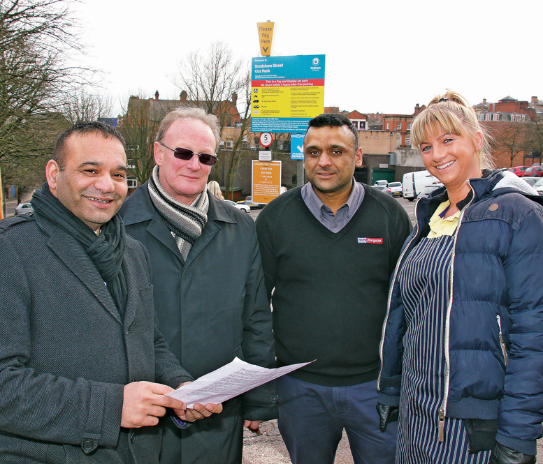 Councillor Shoab Akhtar discusses free parking proposals with local traders
