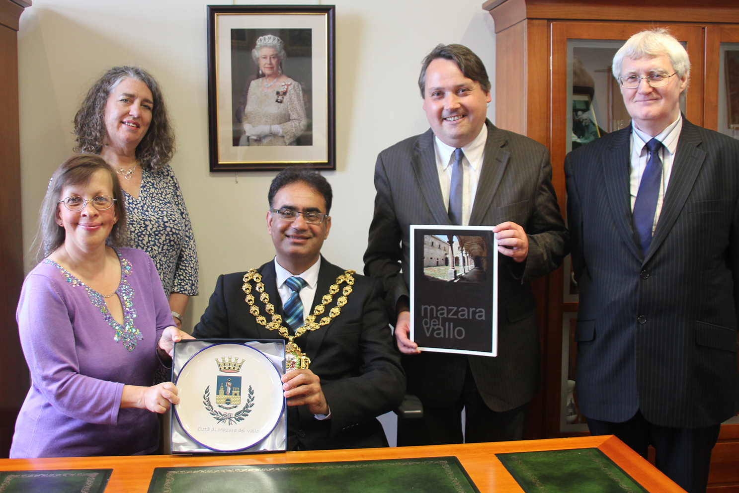 The Mayor of Oldham, Councillor Ateeque Ur-Rehman, presented with the Coat of Arms from Mazara Del Vallo by Peace Talks Oldham members.
