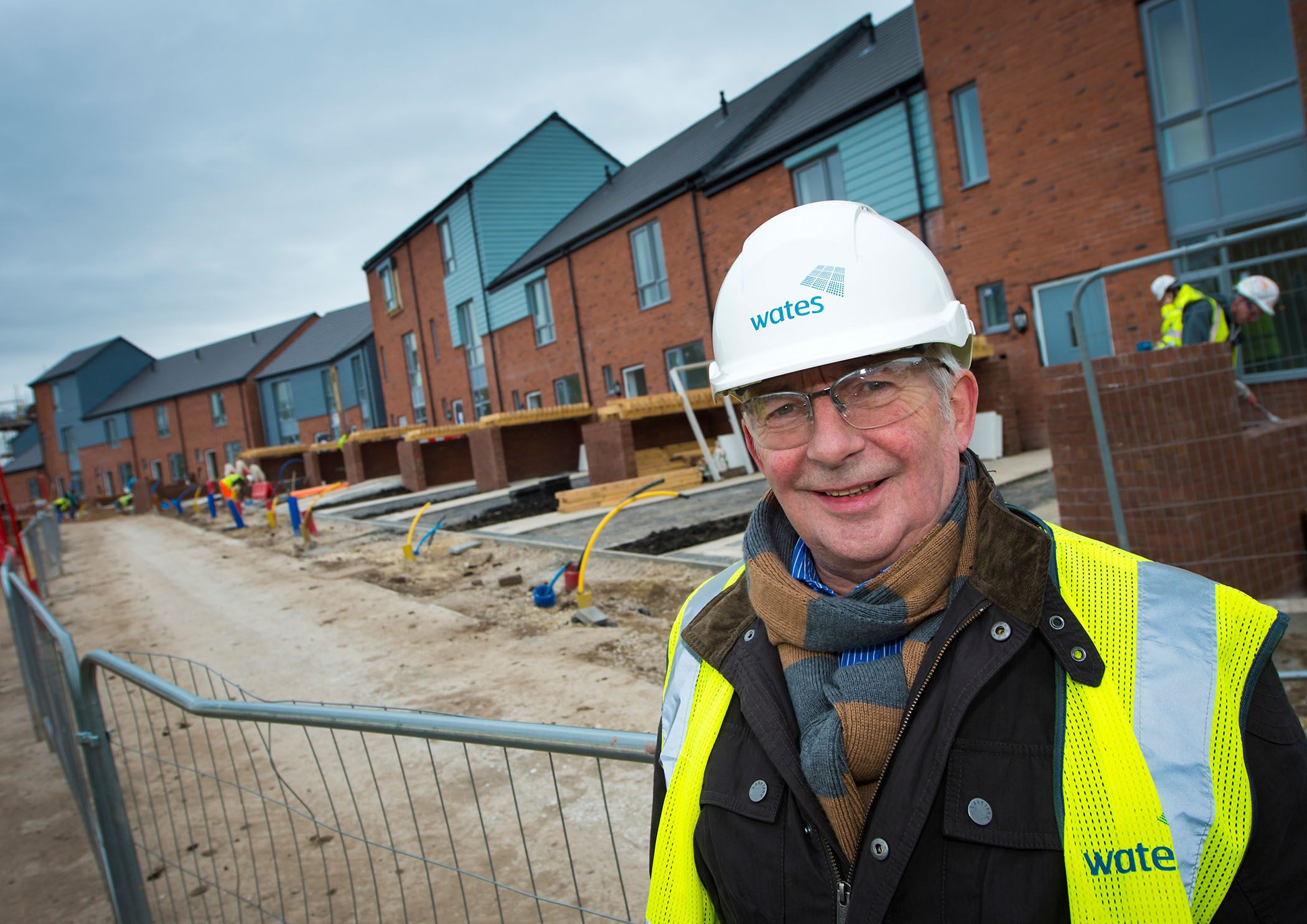 Cllr Dave Hibbert with new council houses