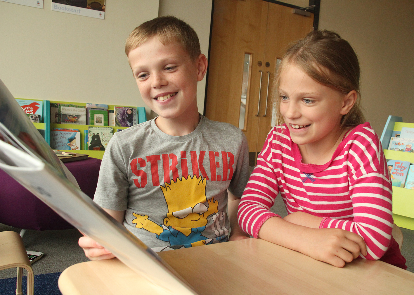 Ben and Nicole, from Chadderton, reading at Oldham Library