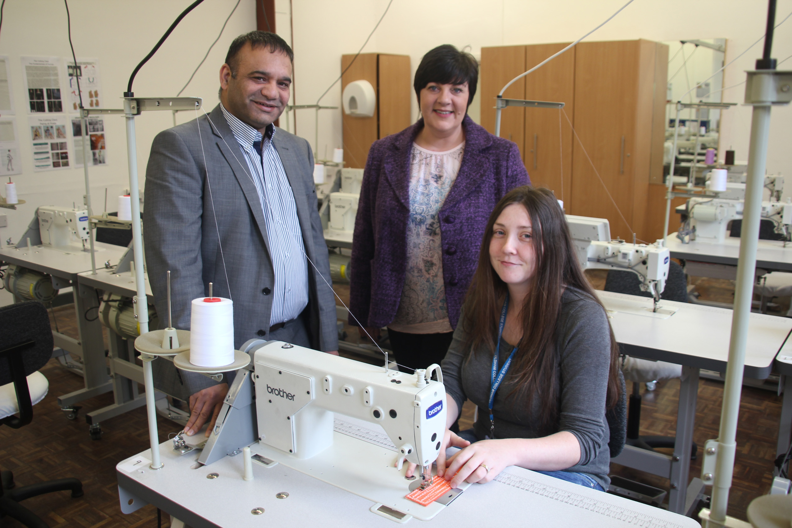 Sewing Academy student Sinead Ingham (pictured right) with Beverley Whittaker (course leader) and Councillor Shoab Akhtar, Oldham Council's Cabinet Member for Education and Skills.
