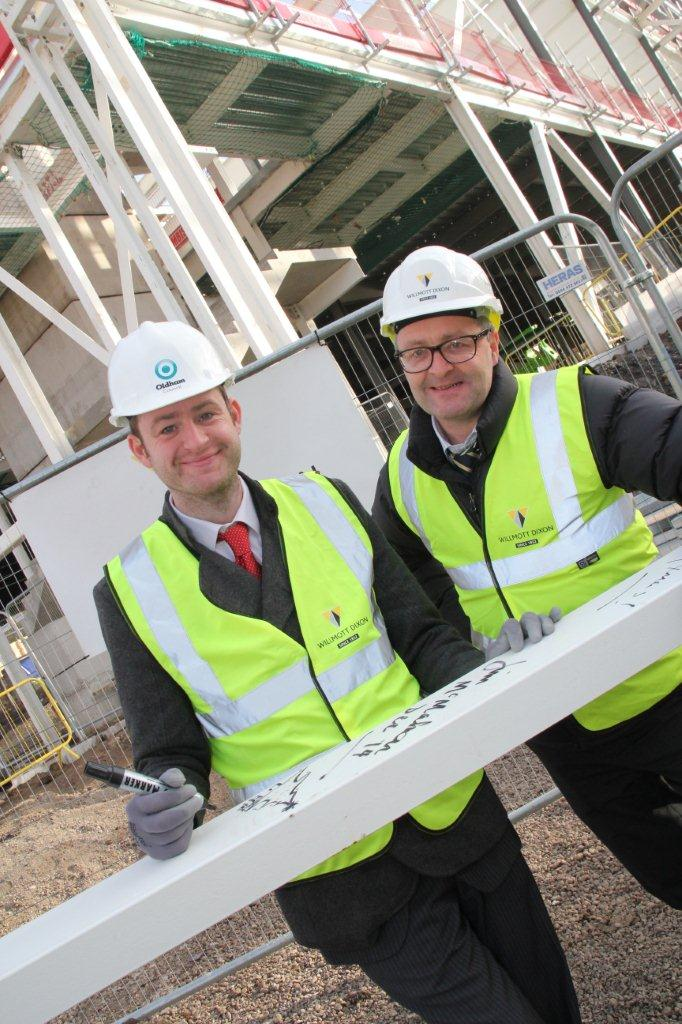 Jim McMahon and Willmott Dixon's Anthony Dillon, MD Northern, at Steel Signing ceremony at Oldham sports centre