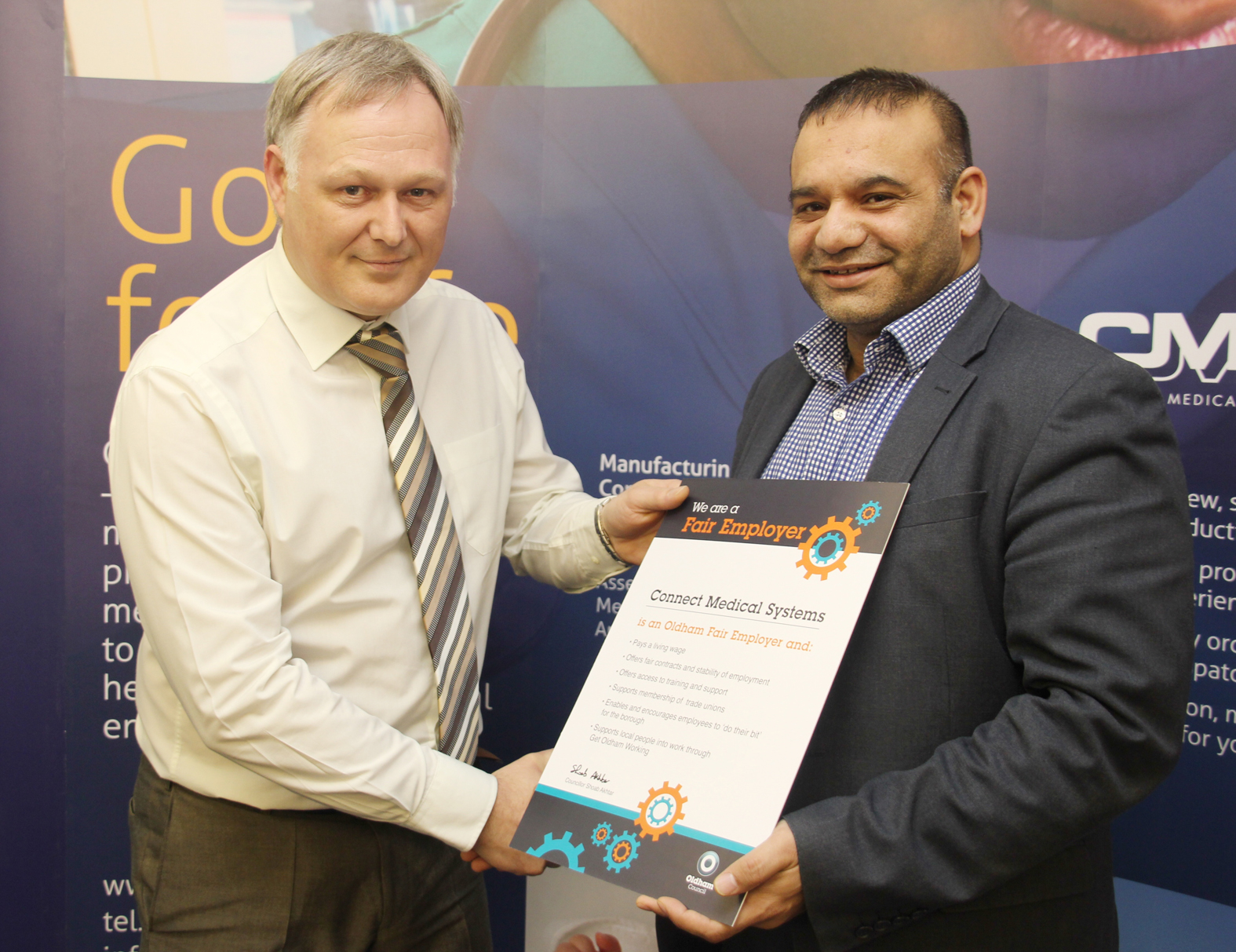 Adrian Todd, Owner and Technical Director of CMS, presented with the Fair Employment Charter, from Councillor Shoab Akhtar, Cabinet Member for Education and Skills.
